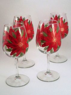 Red Poinsettia flowers stemware - hand painted Christmas glassware - set of 4 via Etsy. Wine Glass Crafts, Wine Craft, Wine Bottle Crafts, Decorated Wine Glasses, Hand Painted Wine Glasses, Christmas Wine Glasses, Wine Bottle Glasses, Bottle Painting, Diy Painting