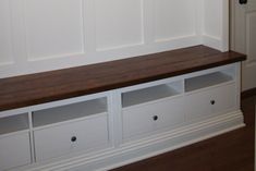 The bench is made from two Hemnes TV consoles from IKEA (about $150 each) and some pine boards, stained to make the wooden top.