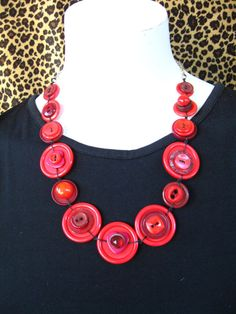 BUTTONS JEWELRY button nacklace  shade of red with silver chain.     buy  necklace and get earring in the same colours for FREE