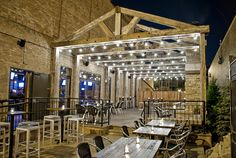 rustic back bar designs commercial | Frontier : Plenty of seating, mood lighting and a rustic edge makes ...
