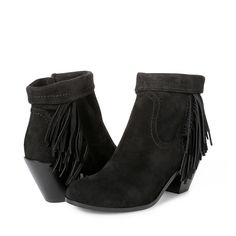 The Louie fringed bootie is a Western-inspired favorite for boho-chic dressing. A sturdy block heel adds height without sacrificing comfort, while thick panels of fringe up the luxe factor. Wear them year-round, cuffed up or down, with everything from classic denim to festival-ready dresses...and everything in between. Zip closure at ankle. Upper Material: Leather or SuedeLining material: FabricHeel Height: 2 in