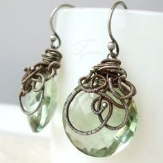 The coiling makes these boring earrings come to like in a funky gothic way.