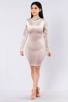 - Available in Burgundy, Taupe, and Black - Velvet Dress - Knee Length - Mock Neck - Long Sleeve - Open Back with Strap Detail - Made in USA - 100% Polyester