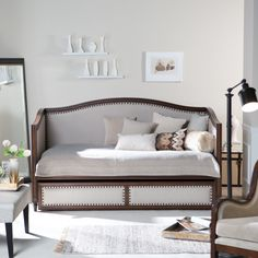 Have to have it. Halstead Upholstered Daybed - $799.99 @hayneedle Looks like furniture, nail heads are nice, arms too claustrophobic?