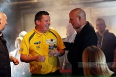 Lord Russell Baker and Dave 'Chizzy' Chisnall Share A Smile at The Norwich Match Play Darts Championships 02-04-2016