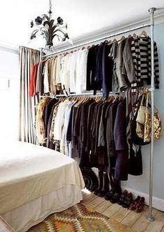 Love this idea of creating an open space for your clothes! No closet, no worries. Create one!
