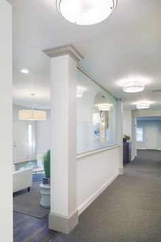 Chiropractic Office Lighting - these lights create rhythm down the corridor, adding interest
