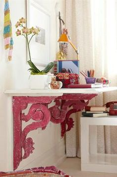 I love this idea of creating a desk using vintage corbels ~ Design Maze