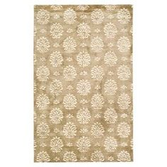 """Create an eye-catching focal point in your living room, foyer, or master suite with this hand-tufted wool rug, highlighted by a flowing organic motif.  Product: RugConstruction Material: WoolColor: Beige and ivoryFeatures:  Made in IndiaHand-tuftedPile Height: 0.63""""Note: Please be aware that actual colors may vary from those shown on your screen. Accent rugs may also not show the entire pattern that the corresponding area rugs have."""