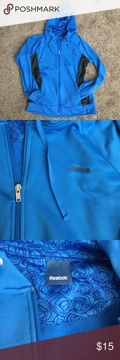 Blue Reebok Hooded Zip Up Great condition! Royal blue zip up. Zipper works great! Pockets. Fitted waist and cuffs. Reebok Tops Sweatshirts & Hoodies