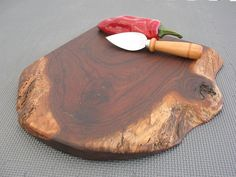 """I love """"live edge"""" cutting boards. This is a TX walnut board from a TX maker. Search """"live edge cutting boards"""" on etsy.com to find absolute one of a kind pieces of wood."""