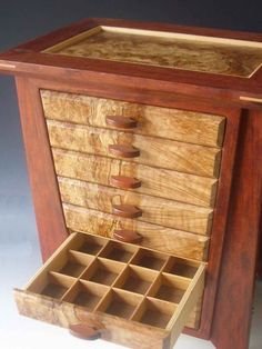 My handmade jewelry boxes are made of exotic woods; each one is unique and serves as a decorative piece as well as storing jewelry.