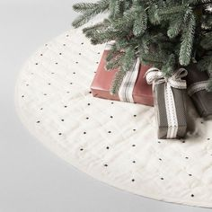 Add some new style to your traditional decor and mix up your Christmas decorations with the Quilted X Pattern Tree Skirt from Hearth & Hand™ with Magnolia. In cream with an allover pattern of little black X's, this quilted tree skirt makes a fun change from typical red or holiday-themed Christmas tree skirts. It'll bring a modern touch to your Christmas decorating that you'll love using for years to come. <br><br>Celebrate the everyday with Hearth & Ha...