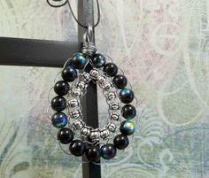 handmade beaded pendant teardrop shaped black and silver glass beads metallic beads wire wrap