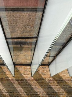 The beams appear to vanish into the brickwork. Glass Structure, Glass Facades, The V&a, Brickwork, Atrium, Beams, Medieval, Restoration, The Past