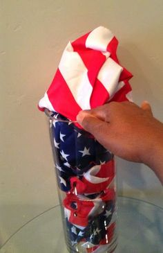 """Create a festive centerpiece by using 99¢ Store """"flags"""" in a clear vase. Great for Memorial Day and 4th of July!"""