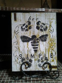bee simple plaque with stand@ rockin b's. 770-253-8730. vendor 103 born in a barn.