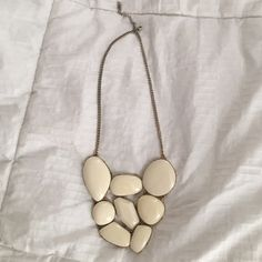 Forever 21 Statement Necklace Forever 21 statement necklace with cream colored smooth stones. Only worn once. Forever 21 Jewelry Necklaces