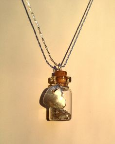 """Every girl loves diamonds!  So perhaps a 2 carat diamond solitaire isn't in the cards this year...  This is a great way to give that special person a little bling in their life and its unique and special!  Each little treasure bottle is accented by a sterling silver heart and 18"""" chain.  The photos show 2 carats rough diamond dust. Select your own carat weight from my other listings.  The heart can also have an initial added for extra personalization!  This unique necklace is sure to be…"""
