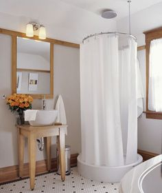small bathroom ideas. I have never seen a circular shower before.  Interesting idea.