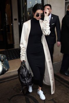 Kendall in black dress and ivory satin duster coat