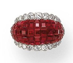 AN INVISIBLY-SET RUBY AND DIAMOND RING, BY VAN CLEEF & ARPELS   Of invisibly-set calibré-cut ruby bombé design, enhanced by graduated circular-cut diamond trim, mounted in platinum, 5½ ins., in a Van Cleef & Arpels blue suede box  By Van Cleef & Arpels, No. 65271