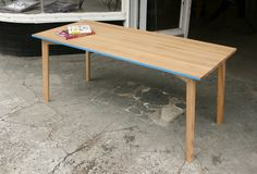 DeckTish by Bastian Greim. A table made of ash with a painted bottom side.