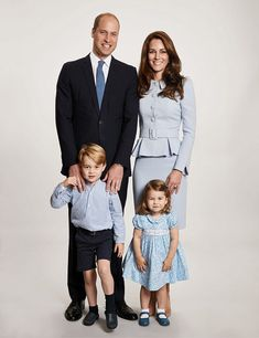 Prince William, Duke of Cambridge looking dashing in a suit and light blue tie, while Catherine, Duchess of Cambridge chose an icy blue Catherine Walker custom wool crepe suit with Prince George, looks smart in navy shorts and a blue and white striped shirt, and Princess Charlotte, wears a floral frock in a similar shade to Mom's suit, in a family portrait taken earlier this year. The image appears on the family's Christmas card.