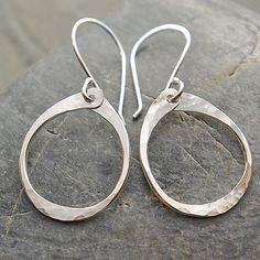 Hoop Dangle Earrings These are Sterling Silver, handmade oval dangles. They are hand forged and not too long, perfect everyday wear go-to earrings.