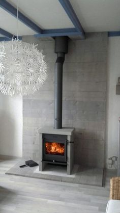 Want to re-create the look of this stovepipe wood stove with the gas fireplace insert Interior Design Living Room, Wood Burning Logs, Hearth, Stove, Wood, Fireplace, Wood Stove Hearth, Pellet Stove, Fireplace Design
