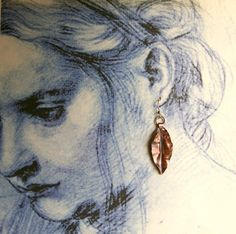 What a fun way to display earrings...a sketch or even a page from a magazine