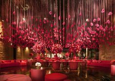 pink decoration with pink feathers, furniture, and flower arrangements