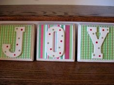 Unfinished wall plaques, paint, scrapbook paper, mod podge, and letters.