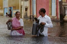 Indian couple during rains in India, from Steve McCurry's blog