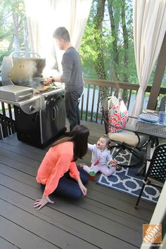 Areas for cooking and dining make this deck a great place for the family to spend time together. Take a look at more photos of the outdoor styling on The Home Depot Blog.