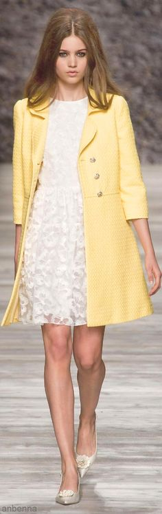 I would wear this little yellow coat and shoes with a cute pair a jeans
