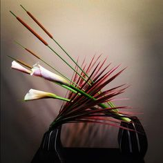 Ikebana  Sogetsu  lesson.  Hum, it would be fun to make a pottery vessel for this arrangement