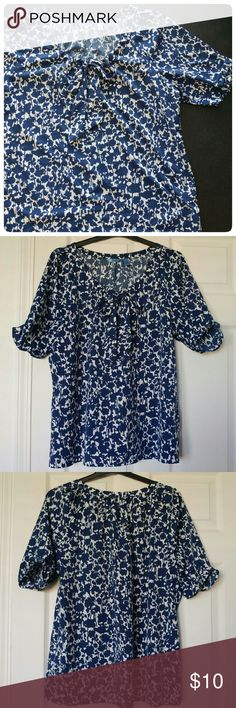 SALE ✨ Adorable 1/2 Sleeve Floral Bow Top I am SO sad to say goodbye to this top, it was one of my favorites! Actually in great condition! This cute top has a scoop neck with a bow (that can tighten the neck) and 1/2 sleeves. The material is 100% polyester, very light but opaque, perfect for summer. Does NOT stretch. XL true to size; 1X can wear if your upper arms are not too big. Comes from a smoke-free and pet-free home. IZOD Tops Blouses