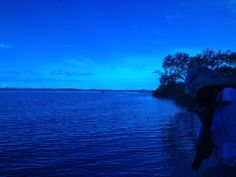 """Blue landscape.  Looking through """"Total Internal Reflection"""" over Southern Moreton Bay and its Islands."""