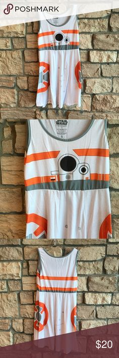 Her Universe Star Wars Dress Her Universe Star Wars Dress. BB8 dress, excellent preowned condition.    Oh, BB-8. You're just too adorable.   BB-8's design printed 360° on this white 95% cotton / 5% spandex A-line dress. Tank top styling with grey edging. Defined waist with 4-panel skirt. Machine wash cold. Tumble dry low  size info Bust36-37 in. Waist29-30 in.  Hips39-40 in. Her Universe Dresses