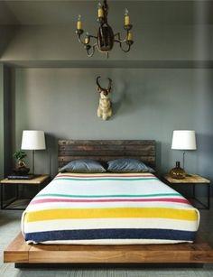 Pendelton blanket, grey walls, recycled wood bed, deer head - guest room