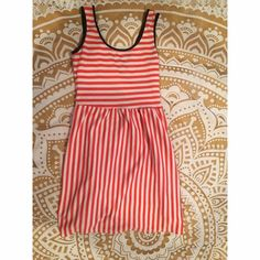 Red Striped Open Back Dress Simple & adorable red and white striped dress with a navy blue lining. the back crosses mid back area and then has a cutout on the lower back. In perfect condition! Dresses