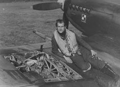 Polish pilot Squadron RAF sits on the damaged wing in a fight his fighter 'Spitfire' Mk.IX. 1944