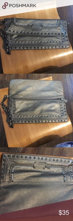 Clutch Gray with rhinestones clutch only carry twice. Great condition. bebe Bags Clutches & Wristlets