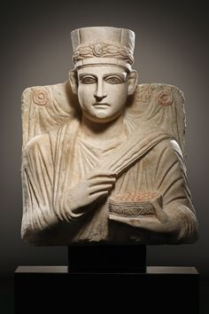A FUNERARY RELIEF OF A PRIEST     H. 54 cm. Limestone, red paint  Palmyra, mid 2nd cent. A.D.