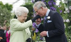 Prince Charles kisses his mom's hand as the Queen bestows the Royal Horticultural Society's Victoria Medal of Honour on her son in 2009. It's no wonder the Prince of Wales received this highest of honours, as he's an avid gardener who has picked up numerous awards at the show.