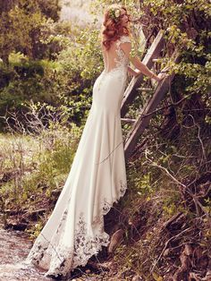 11 Wedding Dress Trends to Get You Excited for 2017 - Odette by Maggie Sottero. Statement backs are one thing, but how about a statement train? Odette by Maggie Sottero features striking cutouts comprised of illusion lace appliques and embroidered accents. And for the chic and trendsetting bride, Bristol by Sottero and Midgley showcases a petal-shaped hemline trimmed in lace appliques.