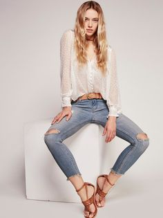 Destroyed Ankle Skinny | Distressed skinny crop jeans with destroyed tears at each knee. 5-pocket style. Zipper and button fly closure. Bottom hems are raw edge and lightly frayed. Stretchy fit.