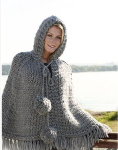 """Ravelry: Poncho with hood and pompoms in 2 threads """"Eskimo"""" or 1 thread """"Polaris"""" pattern by DROPS design (FREE PATTERN) Crochet Poncho Patterns, Crochet Shawl, Knitting Patterns Free, Free Pattern, Knitted Capelet, Knitted Poncho, Knit Shrug, Crochet Capas, Black Crochet Dress"""