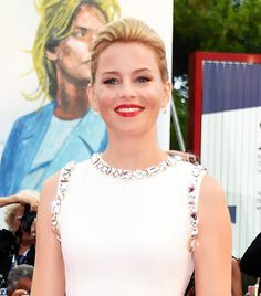 Add some sleek volume to the front of an updo, à la Elizabeth Banks